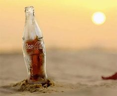 Coca-Cola has unveiled a unique drink that is perfect for a hot summer's day - a bottle made of ice. Coca Cola Bottles, Hot Sauce Bottles, Always Coca Cola, Ice Ice Baby, Bottle Design, Pepsi, Coco, Glass Bottles, Beer Bottle