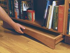 Hidden compartment drawer in bookshelf toe-kick - Source: http://www.finewoodworking.com/SkillsAndTechniques/SkillsAndTechniquesArticle.aspx?id=26008