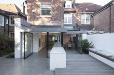 Gabriel's is a minimalist house located in London, England, designed by Paul Archer Design. The new space is organized around a large kitchen island unit that punches through the glass skin of the. Contemporary Architecture, Interior Architecture, Interior And Exterior, Interior Design, Glass Extension, Extension Ideas, House Extensions, Kitchen Extensions, Georgian Homes