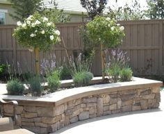 patio decorating ideas plants photos | Here's another raised garden bed idea for a patio. These elegant stone ...