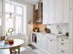 Not this exact look but just to show subway tile I white kitchen with brick wall. Minimalist Kitchen Design, Kitchen Decor, Kitchen Inspirations, Apartment Kitchen, Home Kitchens, Dwell Kitchen, Mexican Style Kitchens, Kitchen Design, Kitchen Remodel