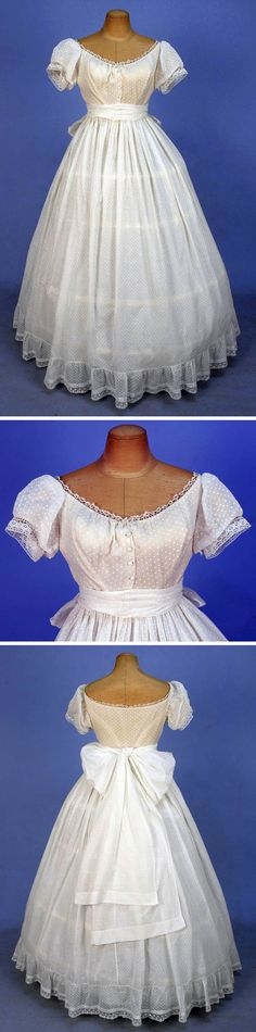 Gown with sash/stole, 1860s. Two-piece white dotted Swiss cotton, boned bodice with short puffed sleeves, front buttons and bobbin lace trim, lined in ivory silk under white cotton. Unlined skirt has gauged gathers with ribbon waistband, hem ruffle trimmed with embroidered net band, self sash. Whitaker Auctions