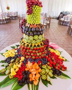 A fruit stand with a selection of fruits for your health conscious guests! How c… A fruit stand with a selection of fruits for your health conscious guests! How colourful & yummy looking is this arrangement 😋! Photo by MP Singh photography Fruit Centerpieces, Fruit Decorations, Edible Arrangements, Fruit Tables, Fruit Buffet, Fruit Trays, Fruit Presentation, Fruit Display Wedding, Deco Fruit