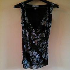 Nine & CO by nine west Sleeveless Top 10% off 2+ bundle! :-)  Black cross over sleeveless summer top gathered on one front side as well as on the shoulders. Beautiful blue & white floral print. Excellent condition! 100% Nylon. Machine wash cold gentle cycle & dry flat. Nine & CO by nine west Tops