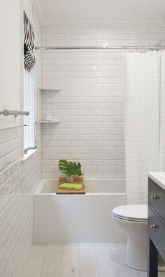 white bevel subway tile bathroom