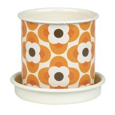 """Orla Kiely Small Enamel Plant Pot - Orange by Orla Kiely. $24.95. Orla Kiely designs home accessories you just long to own. Wipe clean using a soft cloth and soapy water only.. Small enamel plant pot with saucer, in Striped Petal print.. Measures: 4.3""""h x 3.9""""w x 3.9""""d. Modern enamel plant pot with Orla Kiely's distinctive pattern and color. Measures: 4.3""""h x 3.9""""w x 3.9""""d"""