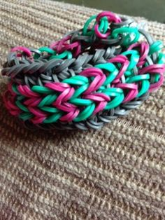 This is the same loom bracelet--mint, fuchsia, and gray.  It is reversible; the reverse side will also be featured.