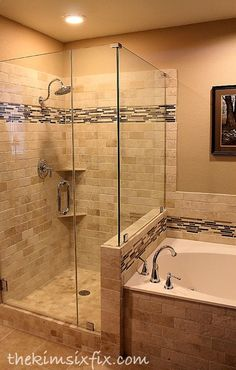 Love the style of this bathroom.  Beautiful travertine with glass tile border.  Love that it borders the bathtub, too!