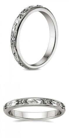 This nature inspired ring is adorned with an engraved pattern of flower buds and stems with diamond accents.