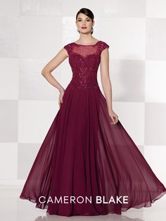 Cameron Blake - 215626 - Chiffon A-line gown with hand-beaded lace and illusion cap sleeves and bateau neckline, beaded lace sweetheart bodice, keyhole illusion back. Matching shawl included.Sizes: 4 – 20Colors: Garnet, Dark Peacock