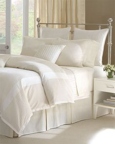 Something about white sheets and fluffy pillows.
