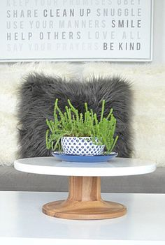 Use the Acacia Wood and Marble Cake Stand to decorate! Try elevating plants or other décor like @tatertotsjello.