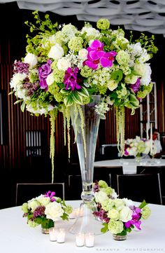 The guest tables were decorated with Lush Romantic Trumpet, which was a beautiful clear glass trumpet vase containing a lush arrangement of green Hydrageas, green Limbo Roses, green Viburnum, ivory rose, white rose and green Amaranthus.