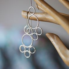 Circle dangle earrings. Recycled sterling silver. $60.00, via Etsy.