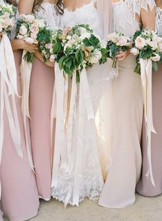 long, creamy white ribbons tied to each bouquet - http://josevillablog.com/wp-content/uploads/2013/01/032.jpg