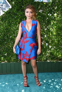 Sarah Hyland pulls off this plunging neckline with bright blue and red with ease.