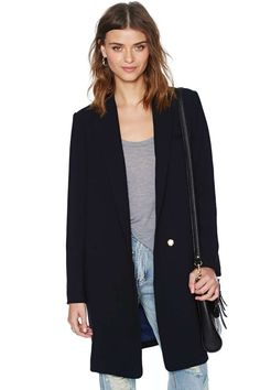 Live large in this structured black blazer featuring a single button closure at front.