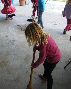 Montessori Sweeping - Care of Environment.... (the kids are sweeping trash to a designated chalk circle)