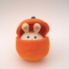 Cute Bunny in an Orange Pumpkin, Easter Toy, Waldorf Inspired, Needle Felted Wool. $30.00, via Etsy.