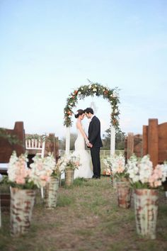 Festooned with greenery, the frame of an old church window formed a charming ceremony arch.