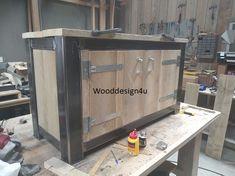Buitenkeuken in aanbouw , blank staal in combinatie met massief hout. Made by Wooddesign4u.nl