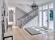 Contemporary White Foyer and Staircase