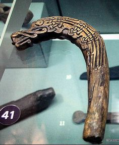 Carved Viking Age wooden handle in the shape of a dragon/beast from Fishable Street, Dublin. It may have been for a whip. Circa 10th century in date. 16,1x10,6x2,5 cm