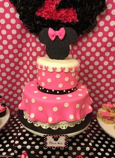 Pink polka dot cake at a Minnie Mouse birthday party! See more party ideas at CatchMyParty.com!