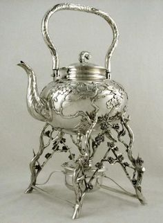 An antique sterling silver tea pot...