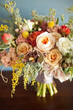 Incredible bouquet by Blossom Sweet with a mixture of muted and bold tones.