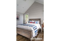 "A nautical theme in red, white and blue adorns the boathouse bedroom.    See more of this home in ""Get the Royal Treatment on Muskoka's Royal Island"" from OUR HOMES Muskoka Spring 2017:  http://www.ourhomes.ca/articles/build/article/get-the-royal-treatment-on-muskokas-royal-island  #cottage"