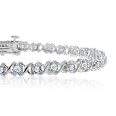 XOXO Diamond Bracelet in 14k White Gold Tennis Bracelet G, SI2, 1.00 cttw, 7 inches. This diamond bracelet features diamonds set in 14k white gold xoxo bracelet with safety clasp. Hugs and Kisses XOXO diamond jewelry. What a romantic gift to win her heart.