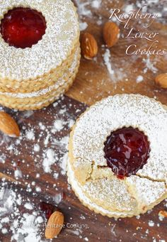 Traditional Raspberry Linzer Cookies are an Austrian rolled Christmas cookie that have raspberry preserves sandwiched between two almond cookies! Linzer Cookies, Almond Cookies, Linzer Tart, Tea Cakes, Holiday Baking, Christmas Baking, Biscotti, Cookie Recipes, Dessert Recipes