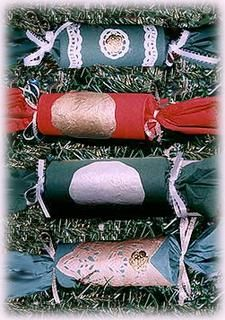 Make your own Christmas Cracker;  Put cracker snap and small gift into empty toilet paper roll. roll in colored tissue paper then glue and tie with ribbon and decorate!  From: http://www.allfreecrafts.com/christmas/crackers.shtml