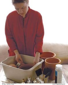 painted terra cotta pots: soak/scrub pot; decorate w/ acrylic craft paints; cover w/ 2 coats MATTE spray acrylic
