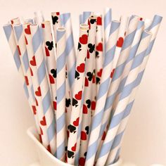 """From the Party Fairy, this sweet set of Alice In Wonderland party straws will add charm and fun to your wedding beverages, cake pops or use halved as cute paper sticks for your desserts. Mixed with """"Playing Cards"""" paper straws, the set includes an assortment of powder blue-striped, red hearts and playing cards straws and more"""