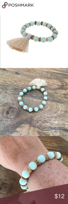 Boho Tassel Bracelet Mint green beaded stretch bracelet with wooden accents and ivory tassel. Fits sm-lg wrists well. Price is firm on boutique items. Thank you! Kismet Jewelry Bracelets