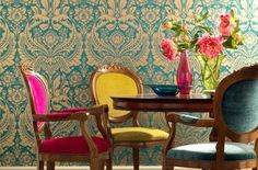 Lovely jewel colored chairs and teal print wallpaper