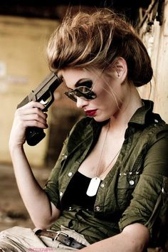 Something about how casually she rest the gun against her head is intriguing.
