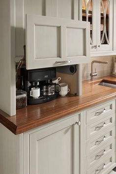 Don't feel limited by a small kitchen space. These 50 designs for kitchen island to inspire you to make the most of your own tiny kitchen. Maximize your kitchen storage and efficiency with these kitchen design ideas and kitchen cabinet design hacks. Custom Kitchen Cabinets, Kitchen Redo, Kitchen Counters, Kitchen Appliances, White Appliances, Kitchen Makeovers, Kitchen Modern, Kitchen Tv, Coffee Corner Kitchen