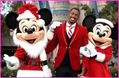 Nick Cannon Hangs Out With Mickey Mouse And Minnie Mouse At The 2012 Disney Parks Christmas Day Parade. [So good to see him looking healthy again!]