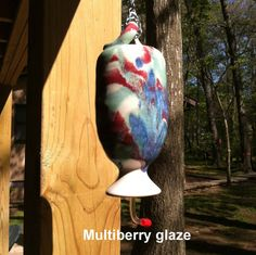Stoneware Pottery Hummingbird Feeder Wheel thrown by Hertzpottery