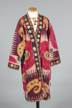 * Striped ikat silk khalats/coats, Uzbek, early 20th century, with embossed coin-like medallion edgings