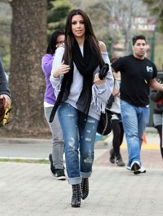 Kim K Kasual off the shoulder with destressed jeans and black scarf.