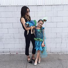 Trick or treating w/ my two tiny peacocks!  see the fun on snap  thriftsnthreads