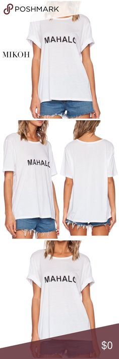 Mahalo Tee Mikoh Swimwear Mahalo T Shirt looks amazing over your favorite Mikoh bikini, or just with a pair of jeans. The oversized fit and short sleeves gives it a relaxed, trendy look, featuring crew neckline for sporty style. Size: 2. Material: 100%Cotton Condition: Excellent. Mikoh Tops Tees - Short Sleeve