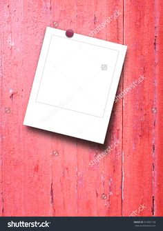 Close-up of one blank instant photo frame with pin on red weathered wooden boards background