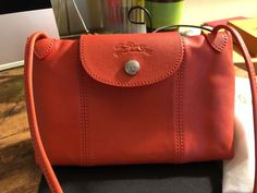 a24156c300068 Longchamp Le Pliage Cuir Crossbody Bag in Orange New Longchamp