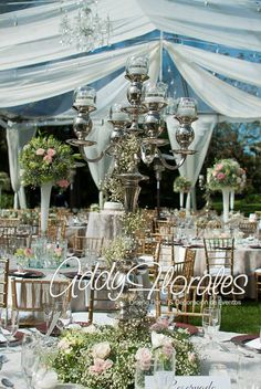 Estuardo & Denise's Wedding in Guatemala. Different styles of floral centerpieces. Transparent tent and drapes.  Wedding Planner: Dream Events Decoration: Addy Florales