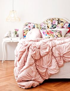 Limited Edition floral bed by Corner Store.love the headboard,  scratch that pink comforter